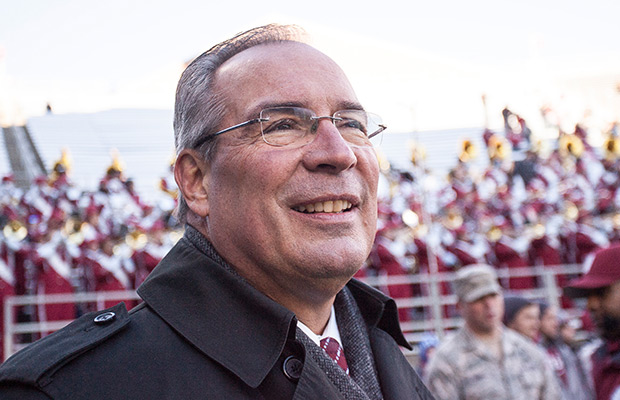 Washington State athletic director Bill Moos views the crowd attending an NCAA college football game against Utah on Saturday, Nov. 23, 2013, at Martin Stadium in Pullman, Wash.
