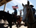 Protester Chanley Iverson of Arizona waves the U.S. flag near the Bureau of Land Management's base camp where seized cattle, that belonged to rancher Cliven Bundy, are being held at near Bunkerville, Nevada April 12, 2014.