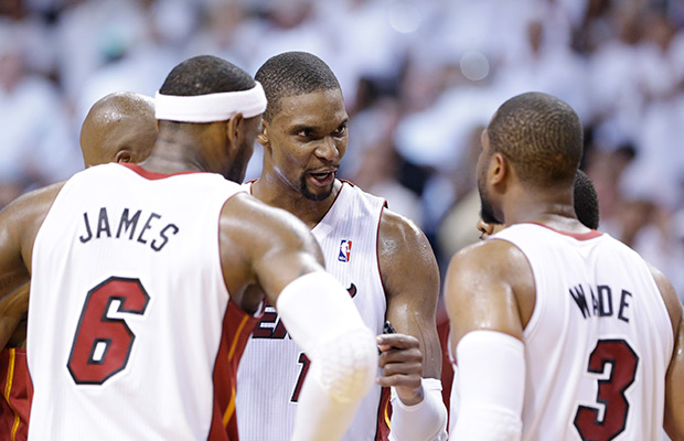 Miami Heat center Chris Bosh, center, talks with forward LeBron James (6) and guard Dwyane Wade (3) during the second half of Game 2 of an Eastern Conference semifinal basketball game against the Brooklyn Nets, Thursday, May 8, 2014 in Miami. The Heat defeated the Nets 94-82.