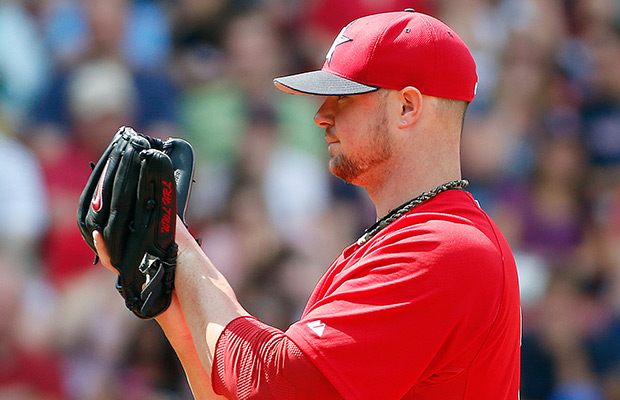 Boston Red Sox's Jon Lester pitches in the seventh inning of the first game of a baseball doubleheader against the Baltimore Orioles in Boston, Saturday, July 5, 2014.