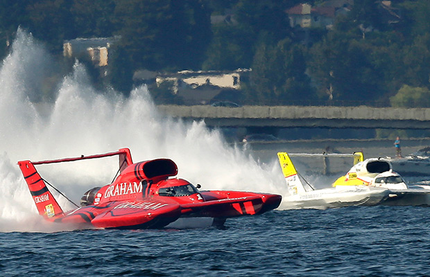 J. Michael Kelly, left, driving the Graham Trucking H1 Unlimited Hydroplane boat, edges out the Les Schwab Team RedDOT boat, right, driven by Jon Zimmerman, in the final race, Sunday, Aug. 3, 2014, in Seattle, of the Albert Lee Appliance Seafair Cup. Kelly finished first and Zimmerman finished second in the race.