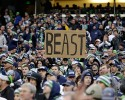 "A fan holds a sign honoring Seattle Seahawks running back Marshawn Lynch, who is known as ""Beast Mode,"" for his aggressive running style, during an NFL football game between the Seahawks and the St. Louis Rams, Sunday, Dec. 28, 2014, in Seattle."
