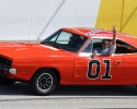 ActorJohn Schnieder star of the 1980's U.S. television show The Dukes of Hazzard, waves from the General Lee before the Kobalt Tools 500 auto race Sunday, March 9, 2008, at Atlanta Motor Speedway in Hampton, Ga. (AP Photo/Dale Davis)