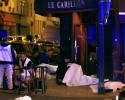 Victims lay on the pavement in a Paris restaurant, Friday, Nov. 13, 2015. Police officials in France on Friday reported a shootout in a Paris restaurant and an explosion in a bar near a Paris stadium. It was unclear if the events were linked. Photo: Associated Press/Thibault Camus