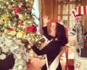 Kimball with Christmas tree, spreading holiday cheer!