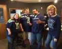 Host Mary Kay (right) with Bellingham Seahawkers President Derek Watson, Vice President Thomas Edin, and Thomas' wife Elena Edin.